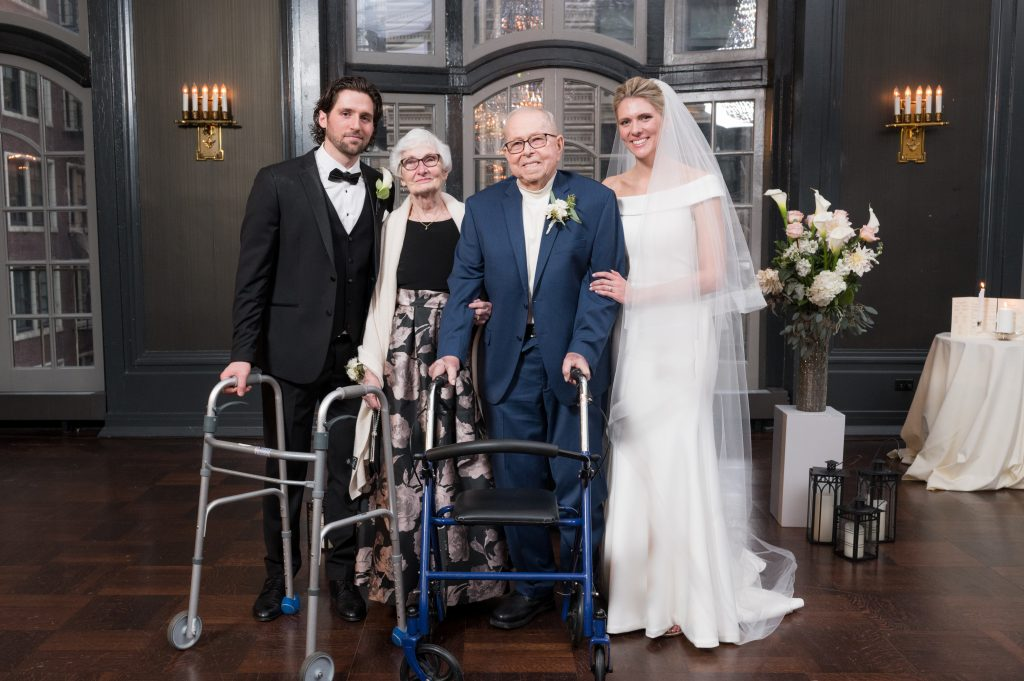 Leslie and Rob's photo with their grandparents at Chicago Athletic Association