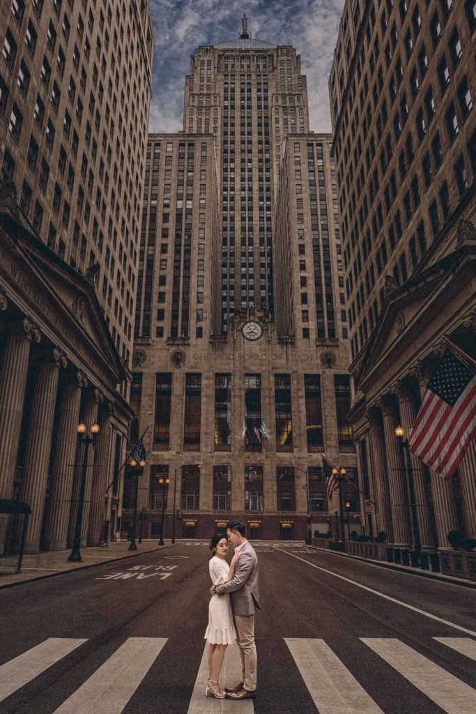 The streamlined and geometric façade of the Chicago Board of Trade building creates truly epic backgrounds for engagement photos.